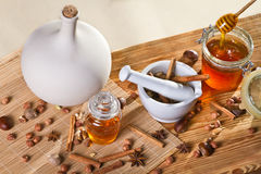 Honey and all sorts of nuts. On wooden shelf Royalty Free Stock Image