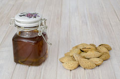 Honey and almonds Stock Image