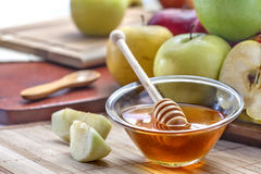 Honey and apple. Domestic apples and honey on the table Stock Photo