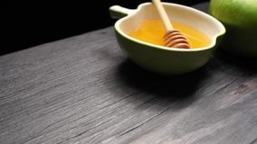 Honey and apple stock footage