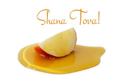 Honey and apple isolated on a white. Rosh hashanah & x28;jewish New Year holiday& x29; concept. Traditional symbol. Text SHANA TOVA means HAPPY NEW YEAR in Royalty Free Stock Photos