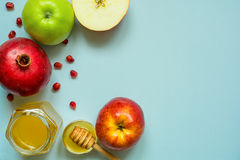 Honey, apple and pomegranate. traditional food for Jewish New Year Holiday, Rosh Hashana. Top view Stock Photo