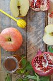 Honey, apple and pomegranate for traditional holiday symbols rosh hashanah jewesh holiday on wooden background royalty free stock photography
