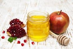 Honey  apple and pomegranate Royalty Free Stock Photos