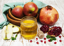 Honey  apple and pomegranate Royalty Free Stock Images