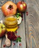 Honey  apple and pomegranate Royalty Free Stock Photo