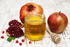 Honey  apple and pomegranate Stock Images