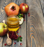 Honey  apple and pomegranate Royalty Free Stock Photography