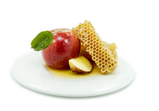 Honey and apple are symbols of rosh hashanah Stock Photos
