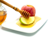 Honey and apple are traditional Jewish food for Rosh hashana Stock Photography