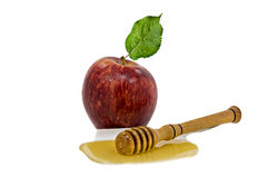 Honey, apple and wooden stirrer on white background Royalty Free Stock Photo