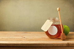 Honey and apple on wooden table with copy space Stock Image
