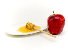 Honey and apple for yom kippur. Honey and apple representing traditional food at yom kippur breaking of the fast Royalty Free Stock Photography
