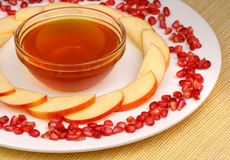 Honey, apples and pomegranate seeds Royalty Free Stock Image
