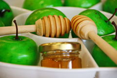 Honey and apples for Rosh Hashana. Honey and apples eaten for Rosh Hashana jewish New Year`s Day to make the new year sweet Stock Photography