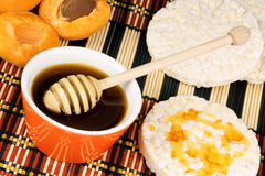 Honey, apricots and rice cakes Royalty Free Stock Photo