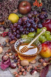 Honey with autumn fruits Royalty Free Stock Photography