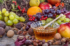 Honey with autumn fruits Stock Photography