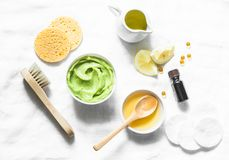 Honey and avocado face mask on light background, top view. Beauty, youth, skin care concept. stock photos