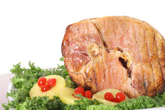 Honey baked ham with garnish Stock Image