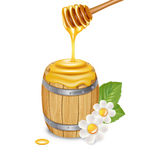 Honey barrel with honey dipper, flowers and leaves. Isolated on white Stock Images