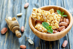 Honey bars with peanuts and mint leaves. Royalty Free Stock Images