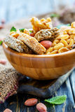 Honey bars with peanuts, sesame seeds and sunflower seeds in a w Royalty Free Stock Photos