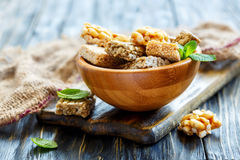Honey bars with peanuts, sesame seeds and sunflower seeds in a w Stock Images
