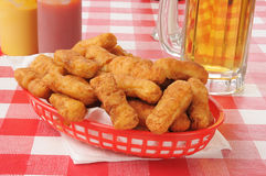 Honey batered chicken strips and beer Royalty Free Stock Photo
