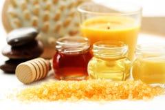 Honey bath time. Bath salt with honey - beauty treatment royalty free stock images
