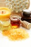 Honey bath time. Bath salt with honey - beauty treatment royalty free stock photo
