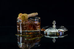Honey in the beautiful vessels of silver and glass Stock Images