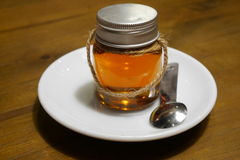 Honey bee bottle royalty free stock photo