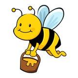 Honey Bee Collecting Honey in Wooden Bucket Stock Photo