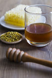 Honey with bee pollen and honeycomb Stock Images