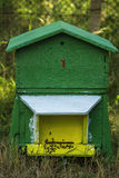 Honey bees swarming on a hive. European honey bees swarming on a hive royalty free stock photo