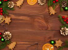 Honey biscuits and mandarins. Christmas decoration on the wooden background. Royalty Free Stock Photo