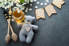 Honey with blossoms and wooden spoons Royalty Free Stock Photo