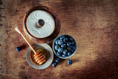 Honey with blueberries Stock Images