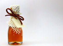 Honey in bottle of love Stock Photos