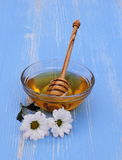 Honey bowl with dipper and blossom Royalty Free Stock Photography