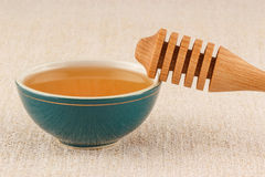 Honey in bowl with dipper Royalty Free Stock Photo