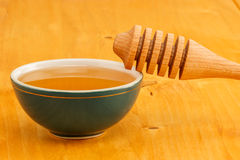 Honey in bowl with dipper Royalty Free Stock Image