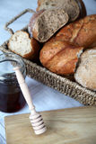 Honey and bread Stock Photography