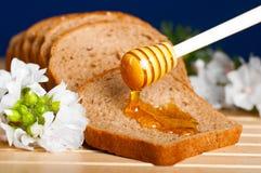 Honey on bread Stock Photo