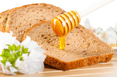 Honey on bread Royalty Free Stock Photography