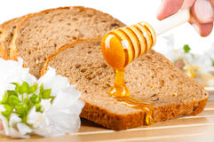 Honey on bread Royalty Free Stock Image