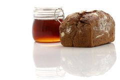 Honey and bread Stock Image
