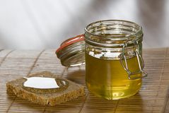 Honey with bread. A honey with bread on the table Royalty Free Stock Photography
