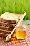 Honey with bread Royalty Free Stock Image
